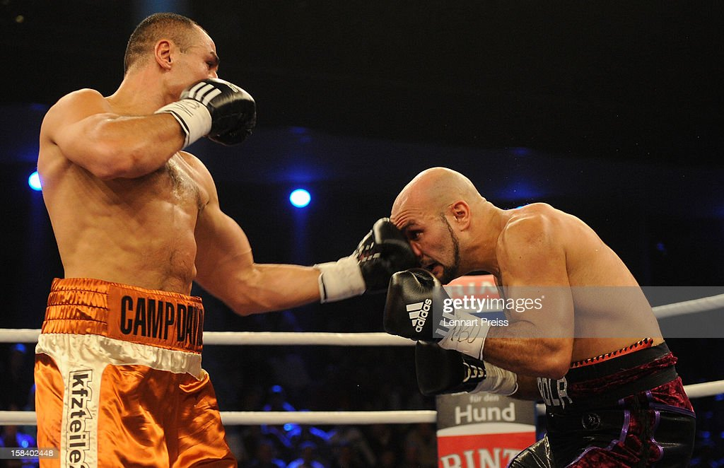 <a gi-track='captionPersonalityLinkClicked' href=/galleries/search?phrase=Arthur+Abraham&family=editorial&specificpeople=643669 ng-click='$event.stopPropagation()'>Arthur Abraham</a> (L) of Germany and Mehdi Bouadla of France exchange punches during the WBO World Championship Super Middleweight title fight at Arena Nurnberger on December 15, 2012 in Nuremberg, Germany.