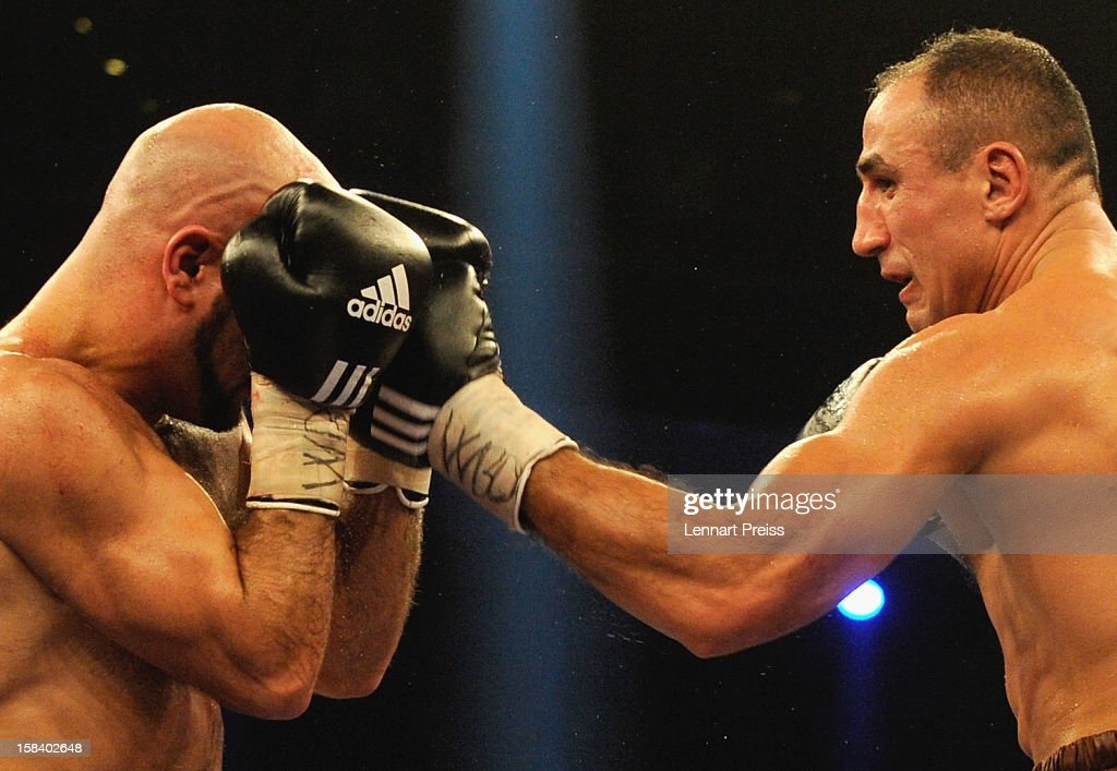 <a gi-track='captionPersonalityLinkClicked' href=/galleries/search?phrase=Arthur+Abraham&family=editorial&specificpeople=643669 ng-click='$event.stopPropagation()'>Arthur Abraham</a> (R) of Germany and Mehdi Bouadla of France exchange punches during the WBO World Championship Super Middleweight title fight at Arena Nurnberger on December 15, 2012 in Nuremberg, Germany.