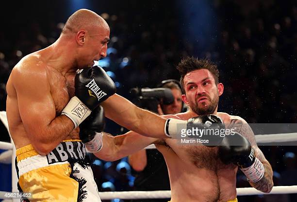 Arthur Abraham of Germany and Paul Smith of Great Britain exchange punches during the WBO World Championship Super Middleweight title fight at...