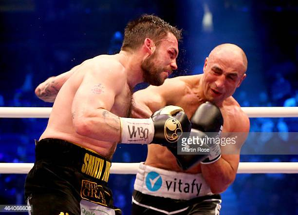 Arthur Abraham of Germany and Paul Smith of Great Britain exchange punches during the WBO World Championship Super Middleweight title fight at o2...