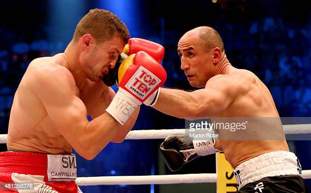 Arthur Abraham of Germany and Robert Stieglitz of Germany exchange punches during the WBO World Championship Super Middleweight title fight at Gerry...