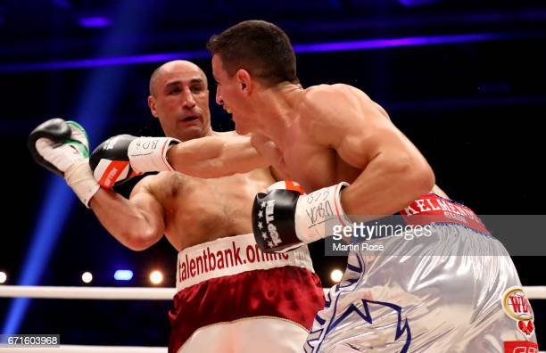 Arthur Abraham of Germany and Robin Kraniqi of Germany exchange punches during their WBO super middleweight elimination fight at Messehalle Erfurt on...