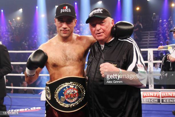 Arthur Abraham of Germany celebrates with his coach Ulli Wegner after defeating Pablo Oscar Natalio Farias of Argentina in their WBO Europe Super...