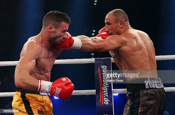 Arthur Abraham of Germany exchanges punches with Giovanni De Carolis of Italy during their WBO International super middleweight title fight at EWE...