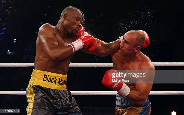 Arthur Abraham of Germany exchanges punches with Willbeforce Shihepo of Namibia during their WBO International super middleweight title fight at...