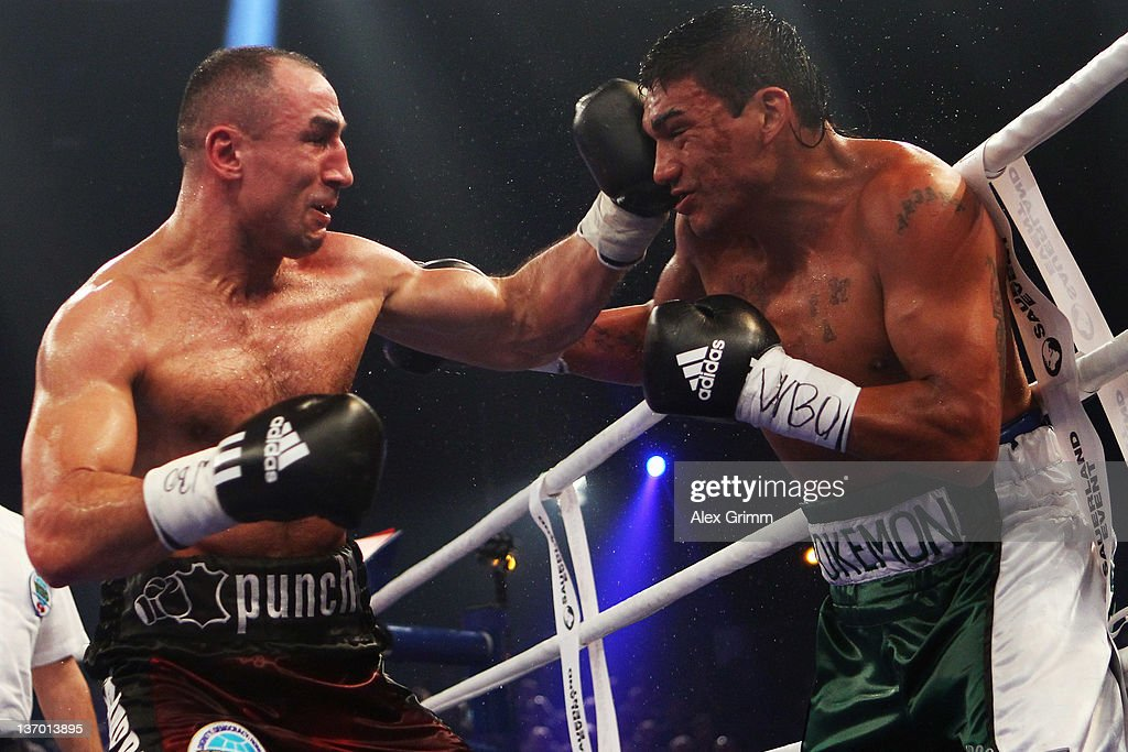 <a gi-track='captionPersonalityLinkClicked' href=/galleries/search?phrase=Arthur+Abraham&family=editorial&specificpeople=643669 ng-click='$event.stopPropagation()'>Arthur Abraham</a> (L) of Germany hits Pablo Oscar Natalio Farias of Argentina during their WBO Europe Super middleweight title fight at Baden-Arena on January 14, 2012 in Offenburg, Germany.