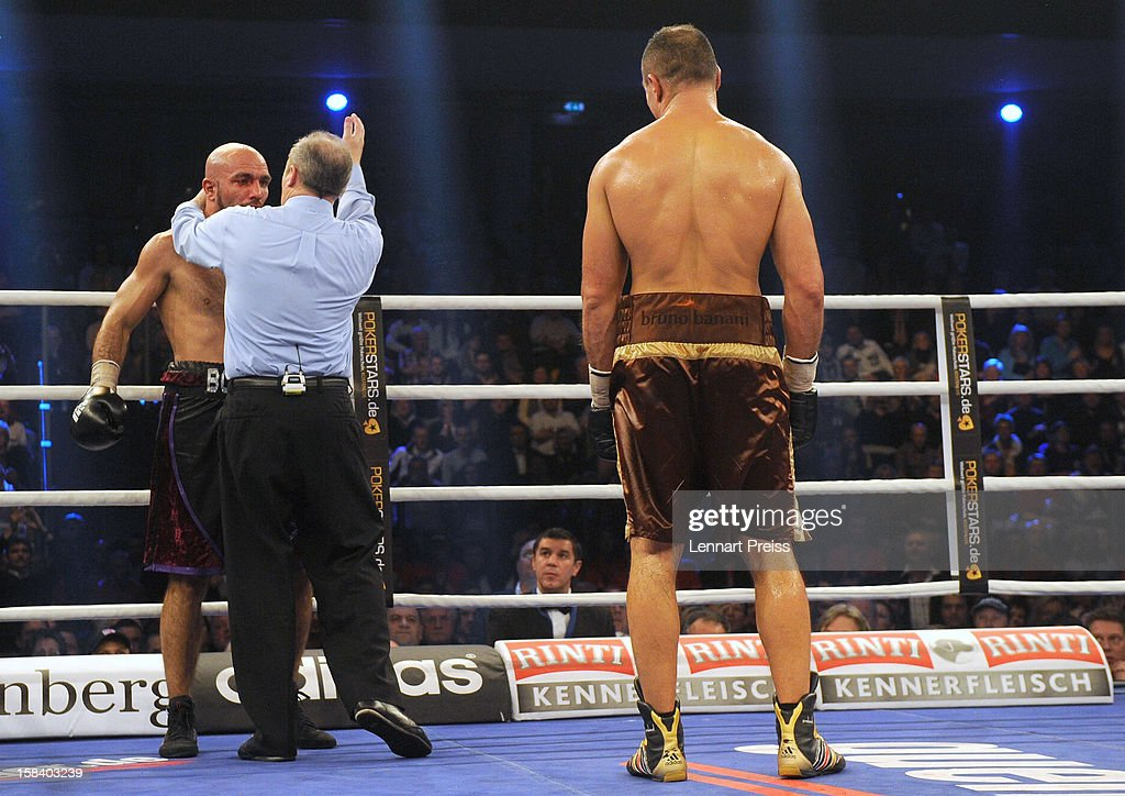 <a gi-track='captionPersonalityLinkClicked' href=/galleries/search?phrase=Arthur+Abraham&family=editorial&specificpeople=643669 ng-click='$event.stopPropagation()'>Arthur Abraham</a> (R) of Germany reacts to a technical KO of Mehdi Bouadla (L) of France during the WBO World Championship Super Middleweight title fight at Arena Nurnberger on December 15, 2012 in Nuremberg, Germany.