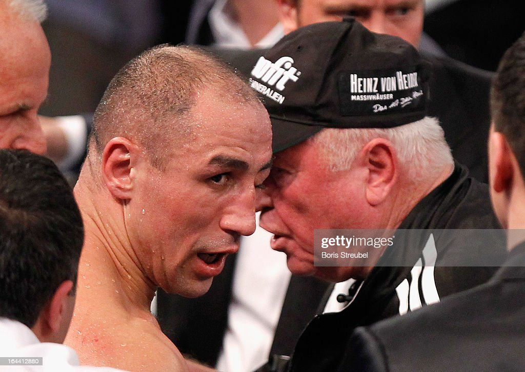 <a gi-track='captionPersonalityLinkClicked' href=/galleries/search?phrase=Arthur+Abraham&family=editorial&specificpeople=643669 ng-click='$event.stopPropagation()'>Arthur Abraham</a> of Germany with a swollen eye talks to his coach <a gi-track='captionPersonalityLinkClicked' href=/galleries/search?phrase=Ulli+Wegner&family=editorial&specificpeople=745804 ng-click='$event.stopPropagation()'>Ulli Wegner</a> after the WBO World Championship Super Middleweight title fight against Robert Stieglitz at Getec Arena on March 23, 2013 in Magdeburg, Germany.