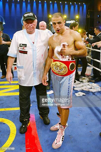Arthur Abraham stands with his coach Ulli Wegner after his victory during the IBF World Championship Middleweight fight between Arthur Abraham of...