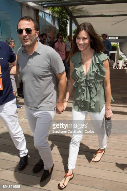 Arthur and his companion Mareva Galanter attend the French Tennis Open 2017 Day Fifthteen at Roland Garros on June 11 2017 in Paris France