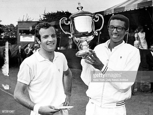 Arthur Ashe holds trophy after defeating Tom Okker of the Netherlands to win the US Open at Forest Hills The first AfricanAmerican to play on the US...