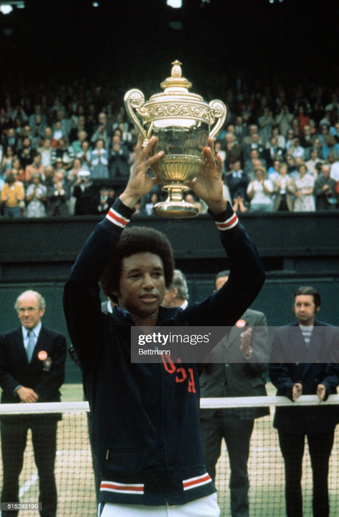 <a gi-track='captionPersonalityLinkClicked' href=/galleries/search?phrase=Arthur+Ashe&family=editorial&specificpeople=215183 ng-click='$event.stopPropagation()'>Arthur Ashe</a> holds up his Wimbledon trophy after defeating Jimmy Connors in the Men's Singles championship 6-1, 6-1, 5-7, 6-4.