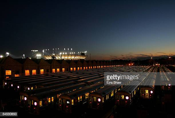 Arthur Ashe Stadium is illuminated behind the railyard of New York City's seven train during the US Open at the USTA National Tennis Center in...