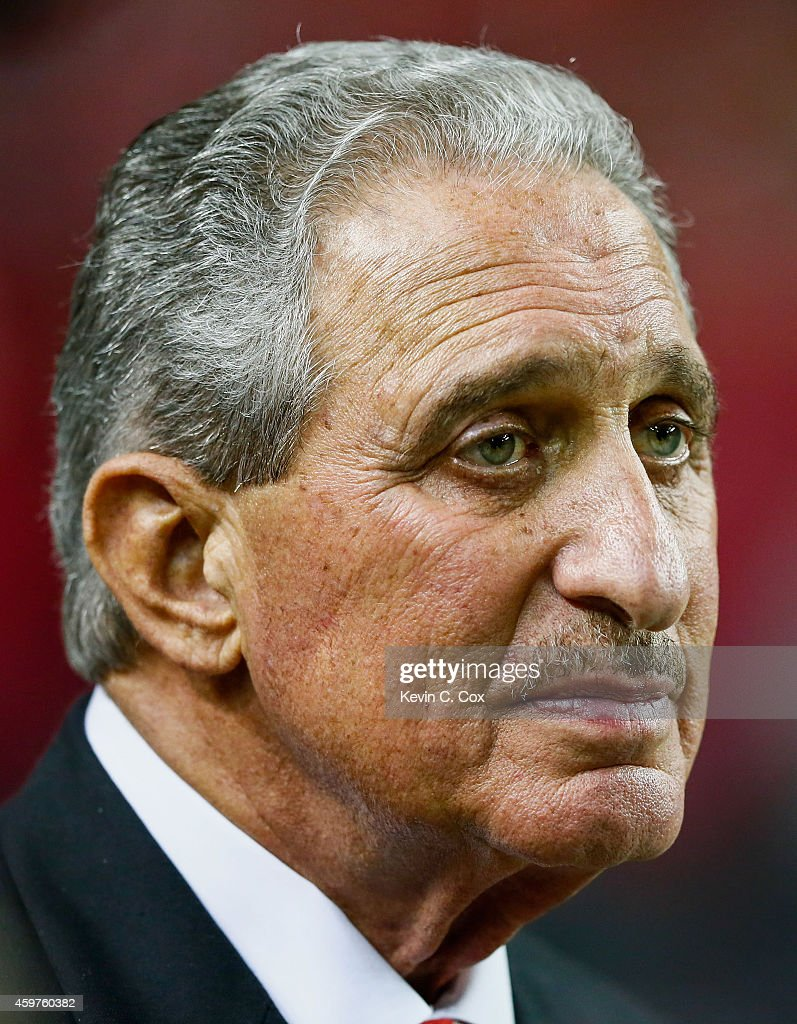 Arthur Blank team owner of the Atlanta Falcons stands on the field after the game against the Arizona Cardinals at the Georgia Dome on November 30...