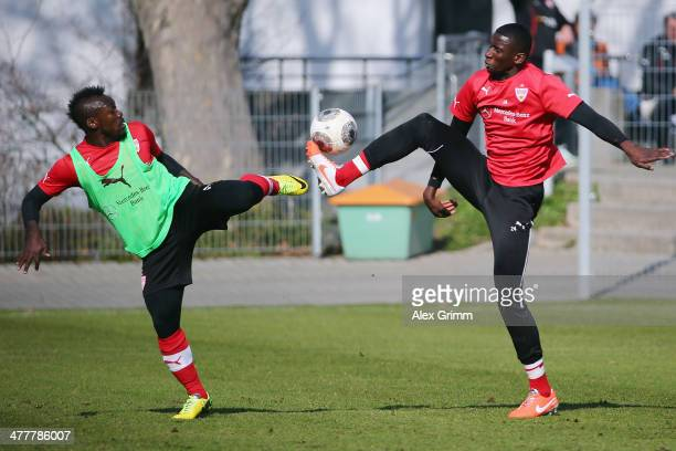 Arthur Boka is challenged by Antonio Ruediger during a VfB Stuttgart training session at the club's training ground on March 11 2014 in Stuttgart...