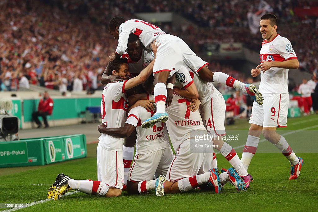 <a gi-track='captionPersonalityLinkClicked' href=/galleries/search?phrase=Arthur+Boka&family=editorial&specificpeople=550855 ng-click='$event.stopPropagation()'>Arthur Boka</a> (C) of Stuttgart celebrates his team's first goal with team mates during the DFB Cup Semi Final match between VfB Stuttgart and SC Freiburg at Mercedes-Benz Arena on April 17, 2013 in Stuttgart, Germany.