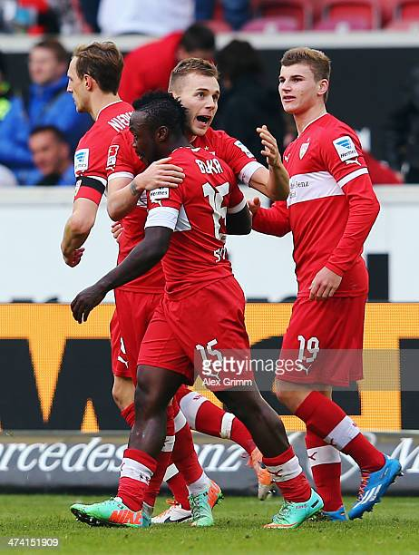 Arthur Boka of Stuttgart celebrates his team's first goal with team mats Alexandru Maxim and Timo Werner during the Bundesliga match between VfB...