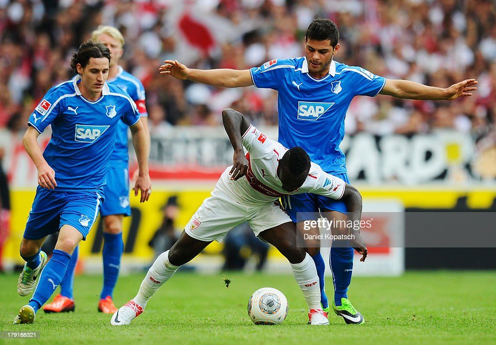 Arthur Boka of Stuttgart (C) is challenged by Kevin Volland of Hoffenheim during the Bundesliga match between VfB Stuttgart and 1899 Hoffenheim at Mercedes-Benz Arena on September 1, 2013 in Stuttgart, Germany.
