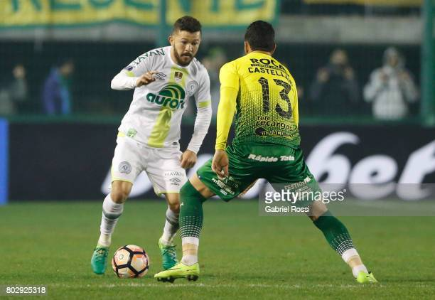 Arthur Caike of Chapecoense fights for the ball with Gonzalo Pablo Castellani of Defensa y Justicia during a first leg match between Defensa y...