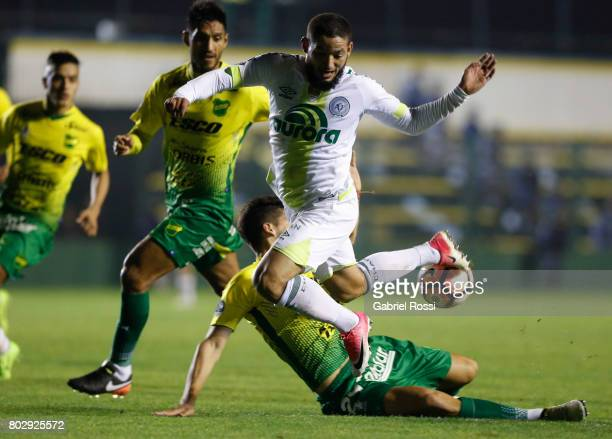 Arthur Caike of Chapecoense fights for the ball with Lucas Bareiro of Defensa y Justicia during a first leg match between Defensa y Justicia and...