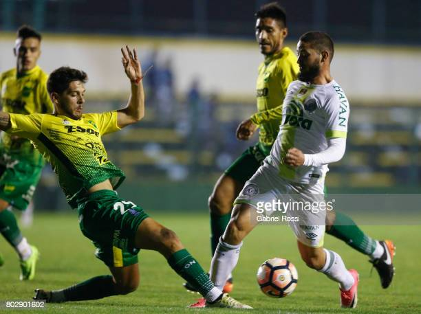 Arthur Caike of Chapecoense fights for the ball with Mariano Bareiro of Defensa y Justicia during a first leg match between Defensa y Justicia and...