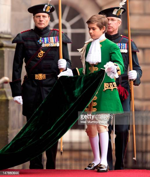 Arthur Chatto carries Queen Elizabeth II's robes as she arrives at St Giles' Cathedral to attend the Thistle Service on July 5 2012 in Edinburgh...