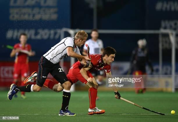Arthur De Sloover of Belgium battles with Niklas Wellen of Germany during day 9 of the FIH Hockey World League Men's Semi Finals final match between...