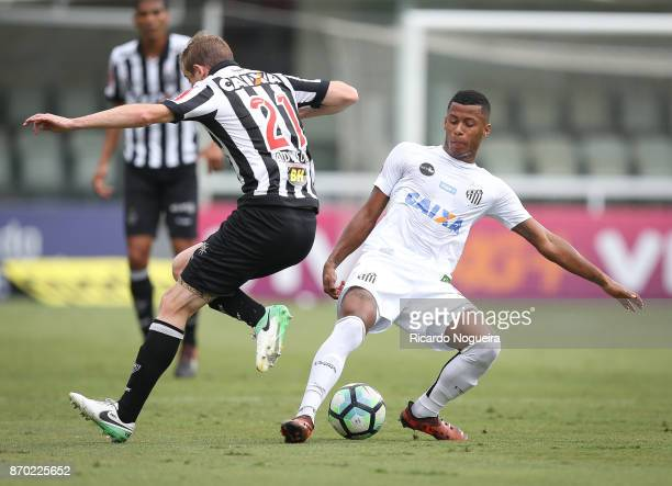 Arthur Gomes of Santos battles for the ball with Adilson of Atletico Mineiro during the match between Santos and Atletico Mineiro as a part of...