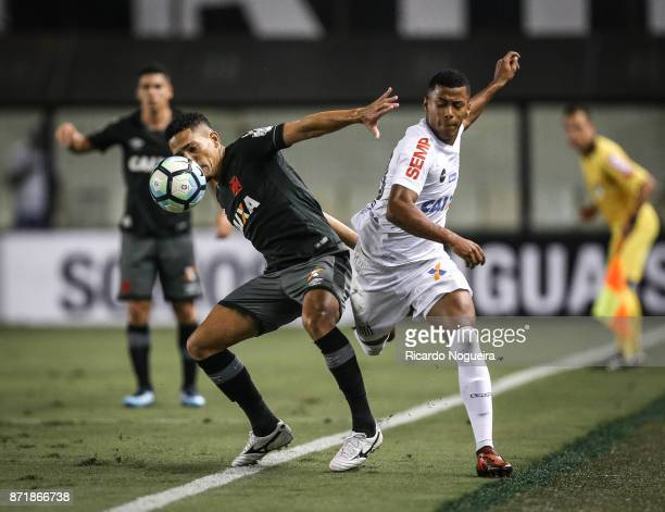 Arthur Gomes of Santos battles for the ball with Gilberto of Vasco during the match between Santos and Vasco da Gama as a part of Campeonato...