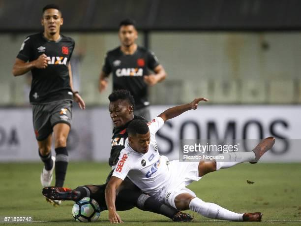 Arthur Gomes of Santos battles for the ball with Paulao of Vasco during the match between Santos and Vasco da Gama as a part of Campeonato Brasileiro...