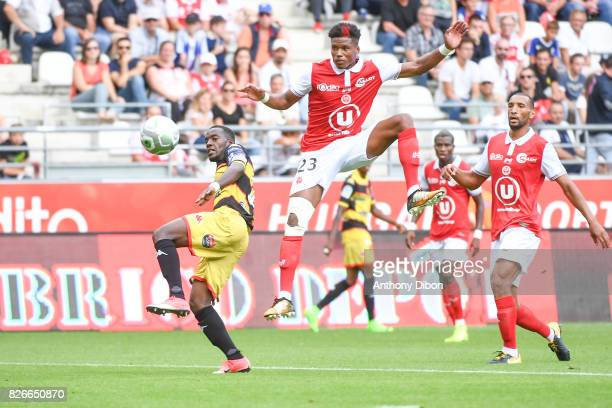 Arthur Gomis of Orleans and Julian Jeanvier of Reims during the French Ligue 2 match between Reims and Orleans at Stade Auguste Delaune on August 5...