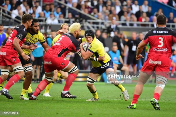 Arthur Iturria of Clermont takes on Romain Taofifenua of Toulon during the the Top 14 Final between RC Toulon and Clermont Auvergne at Stade de...