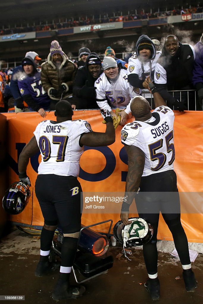 Arthur Jones #97 and Terrell Suggs #55 of the Baltimore Ravens celebrate with fans in the stands after the Ravens won 38-35 in the second overtime against the Denver Broncos during the AFC Divisional Playoff Game at Sports Authority Field at Mile High on January 12, 2013 in Denver, Colorado.
