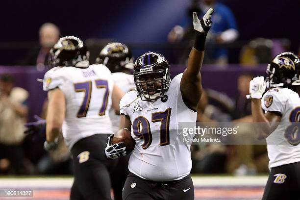 Arthur Jones of the Baltimore Ravens reacts after he recovered a fumble in the second quarter against the San Francisco 49ers during Super Bowl XLVII...