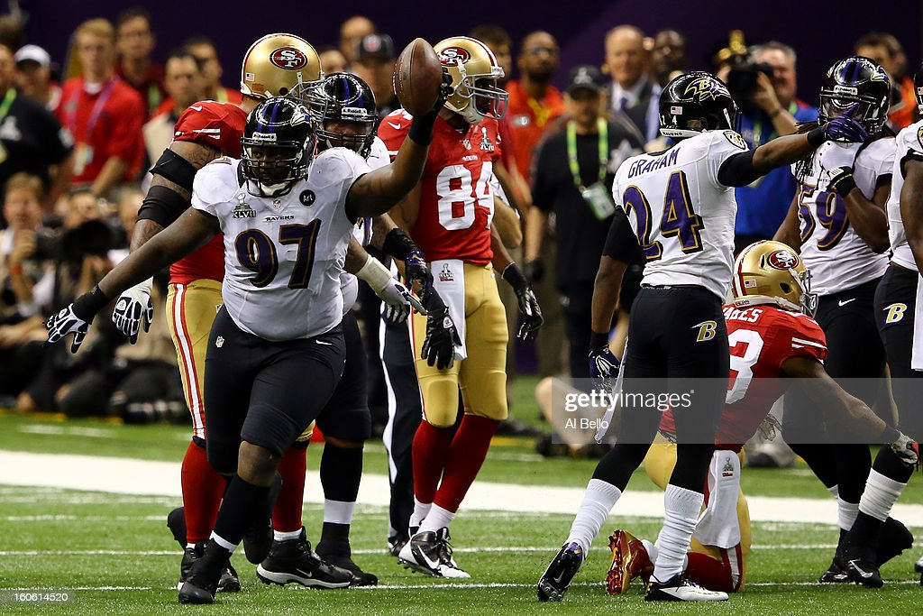 Arthur Jones #97 of the Baltimore Ravens reacts after recovering a fumble from <a gi-track='captionPersonalityLinkClicked' href=/galleries/search?phrase=LaMichael+James&family=editorial&specificpeople=5532594 ng-click='$event.stopPropagation()'>LaMichael James</a> #23 of the San Francisco 49ers in the second quarter during Super Bowl XLVII at the Mercedes-Benz Superdome on February 3, 2013 in New Orleans, Louisiana.