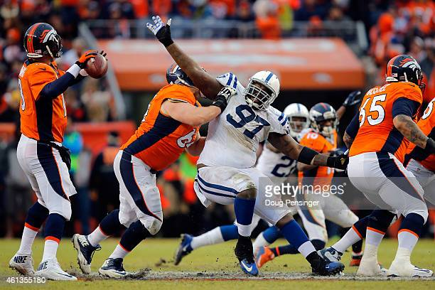 Arthur Jones of the Indianapolis Colts works against the Denver Broncos offensive line as Peyton Manning of the Denver Broncos drops back to pass...