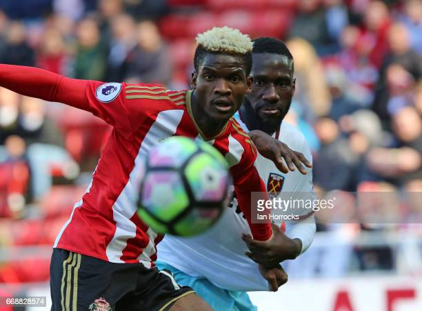 Arthur Masuaku of West Ham challenges Didier N'Dong of Sunderland during the Premier League match between Sunderland and West Ham United at Stadium...
