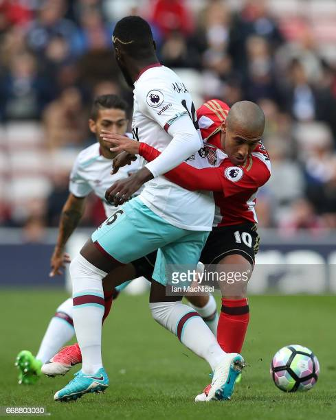 Arthur Masuaku of West Ham United and Wahbi Khazri of Sunderland battle for possession during the Premier League match between Sunderland and West...