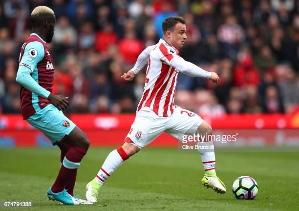 Arthur Masuaku of West Ham United closes down Xherdan Shaqiri of Stoke City during the Premier League match between Stoke City and West Ham United at...