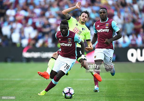 Arthur Masuaku of West Ham United is challenged by Adam Smith of AFC Bournemouth during the Premier League match between West Ham United and AFC...