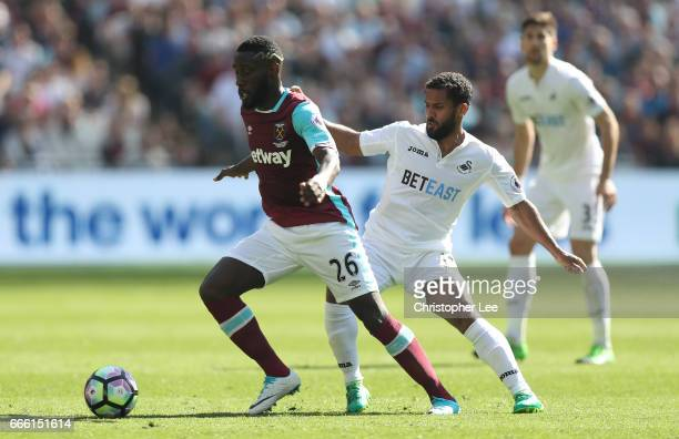 Arthur Masuaku of West Ham United is put under pressure from Wayne Routledge of Swansea City during the Premier League match between West Ham United...