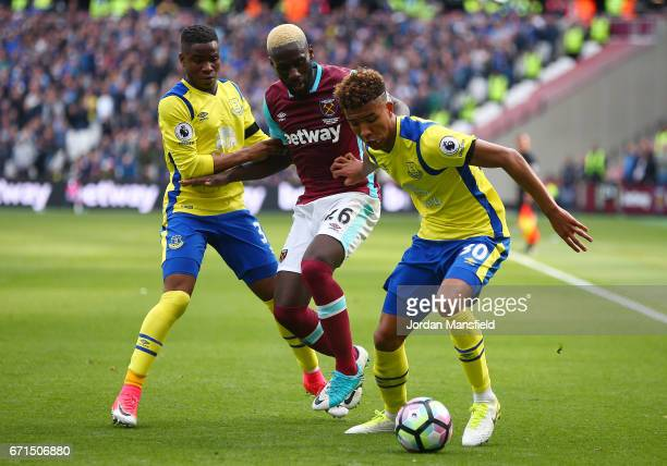 Arthur Masuaku of West Ham United puts pressure on Mason Holgate of Everton as he is closed down by Ademola Lookman of Everton during the Premier...