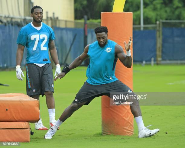Arthur Miley looks on as Charles Harris of the Miami Dolphins runs a drill during the teams OTA's on June 5 2017 at the Miami Dolphins training...