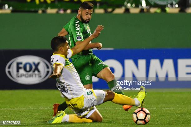 Arthur of Brazil's Chapecoense vies for the ball with Luis Jerez of Argentina's Defensa y Justicia during their 2017 Copa Sudamericana football match...