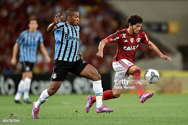 Arthur of Flamengo struggles for the ball with aMatheus Biteco of Gremio during a match between Flamengo and Gremio as part of Brasileirao Series A...