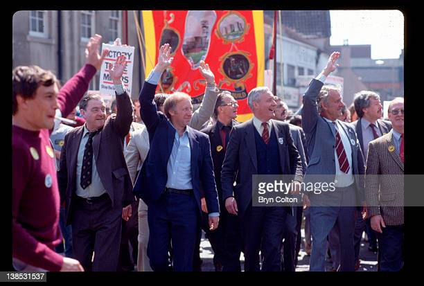 Arthur Scargill president of the National Union of Mineworkers center left and Tony Benn a Labour member of parliament center right wave to miners...