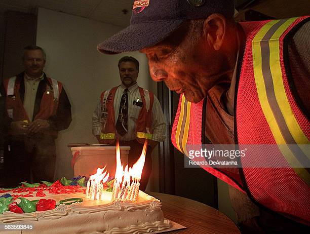 Arthur Winston a South Los Angeles resident and MTA's most senior employee blows out the candles on his birthday cake to celebrate his 97th birthday...