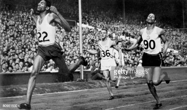 Arthur Wint of Jamaica BWI wins the Summer Olympic 400meter dash at Wembley Stadium Eng leading his teammate Herb McKenley who placed second and the...