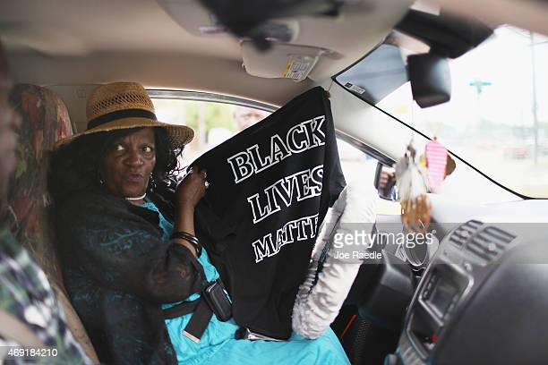 Arthuree Johnson shows her husband Joe Gibbs the shirt she bought reading 'Black Lives Matter' that are being sold near the spot where Walter Scott...