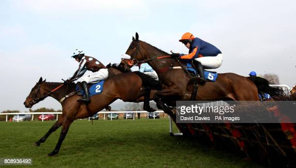 Arthur's Pass ridden by Rhys Flint leads the field over a hurdle on their way to victory in Bet Live At corbettsportscom 'National Hunt' Novices...